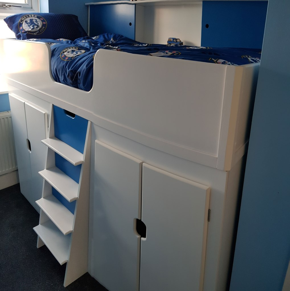 Chelsea Bed Bespoke Children's Themed High Sleeper with Twin Wardrobes and Central Stairs with Drawers for Extra Storage and easy access sliding door storage above.