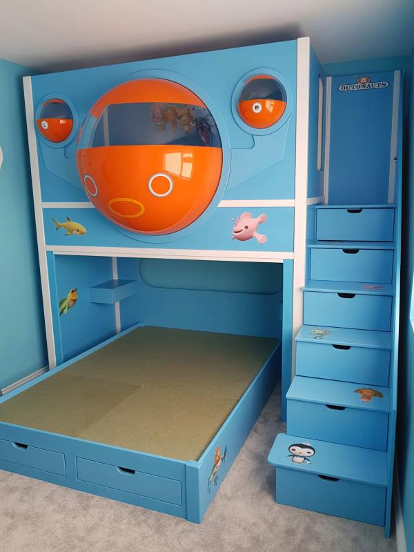 This is our Octonauts Pod twin Bed with a guest bed on the bottom. Built in blue with orange domes. With six stairs all with drawers and two drawers under the bottom bed.
